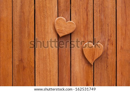 Wood background with heart made from wood  - stock photo