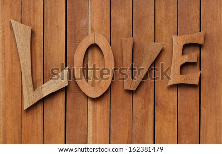 Wood background with love word - stock photo