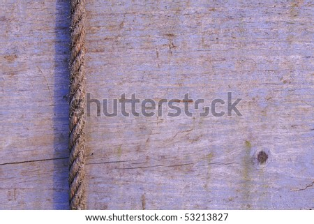 Wood background with old vertical rope - stock photo