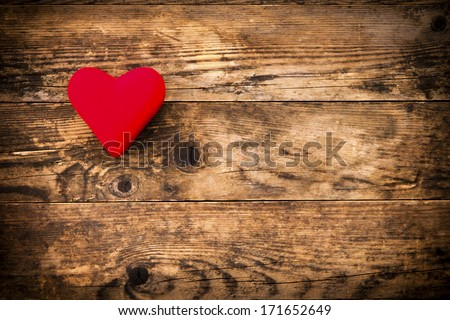 Wood background with red heart and nothing else. - stock photo