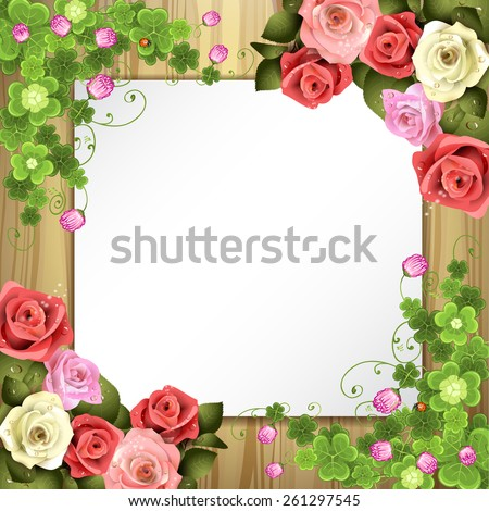 Wood background with sheet of paper, clover and roses - stock photo