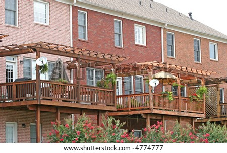 Wood balconies on the back of brick townhouses