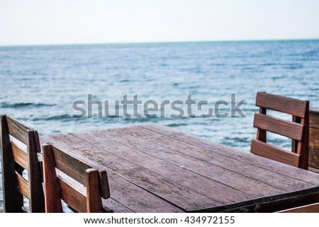 Wood Beach Table at Restaurant with sea beach background