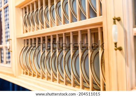 Wood beautiful custom kitchen cupboard - stock photo