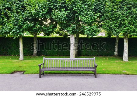 Wood Bench in a Beautiful Public Park - stock photo