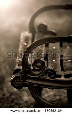 Wood Bench in the autumn park -sepia tone - stock photo