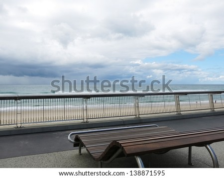 wood bench with the beach