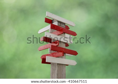 Wood blank direction sign isolated on green background