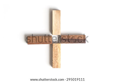 Wood block as plus sign on white background .