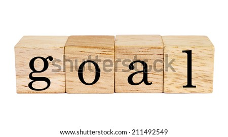 wood blocks with goal word on white