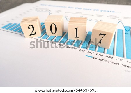 wood blocks with number 2017 on office table