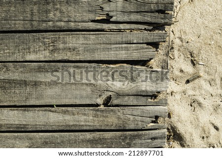Wood boards on the beach. Old vintage woods - stock photo