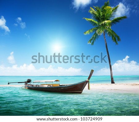 wood boat on the beach - stock photo