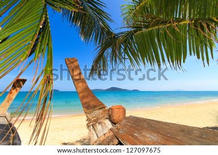 wood boat on the beach at Holidays sunny tranquil paradise beach - stock photo