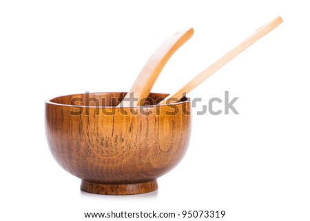 wood bowl and spoon isolated in white background