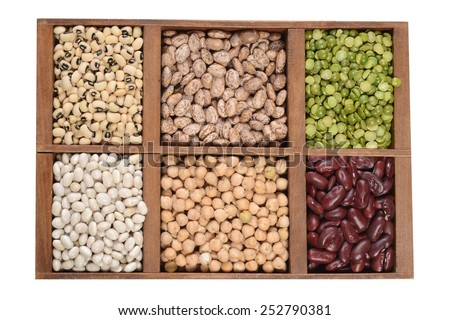wood box of dried beans and peas - stock photo
