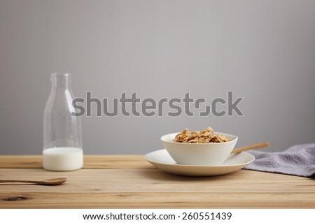wood breakfast table and grey wall, healthy breakfast morning - stock photo