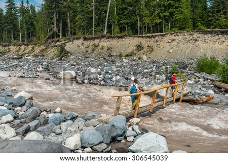 wood bridge across  Nisqually River scene on summer time in mt.Rainier national park,Wa,Usa