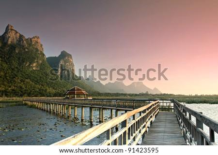 Wood Bridge and Mountain At Dusk - stock photo