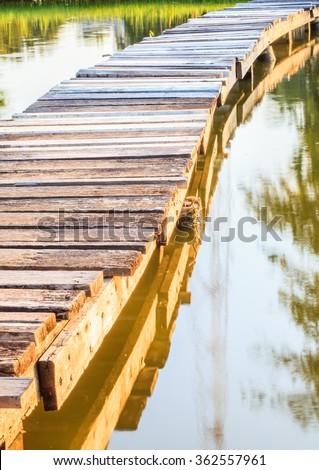wood bridge walk in the park  - stock photo