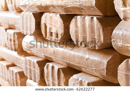 wood briquets in the cellar to heat for the winter - stock photo