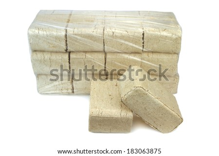 wood briquettes isolated on white background. - stock photo