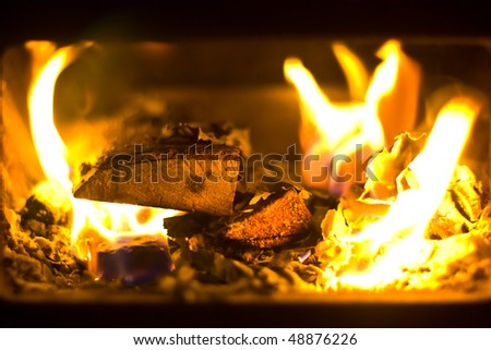 wood burning in furnace in a home during winter - stock photo
