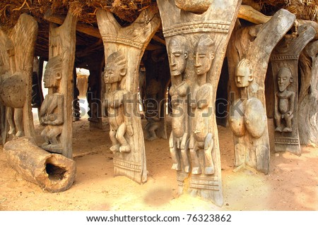 Wood carved human figures supporting a Dogon building in Mali - stock photo