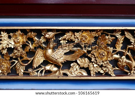 Wood Carving Chinese Phoenix on Outside Temple Door - stock photo