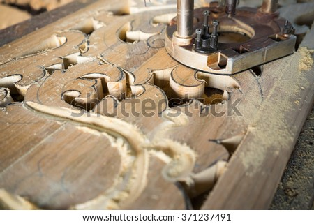 Wood carving craft work with saw tool.