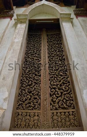 Wood carving door in sanctuary, Uttaradit, northern of Thailand - stock photo