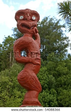 Wood carving of Maori figurine - stock photo
