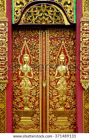 Wood carvings on a temple door of Wat Fon Soi, Chiang Mai, Thailand