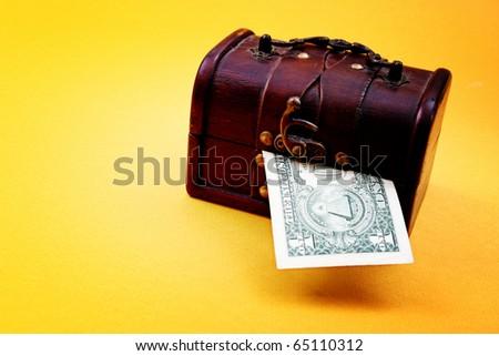 Wood cashbox isolated on yellow - stock photo