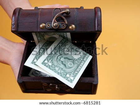 Wood cashbox isolated on yellow
