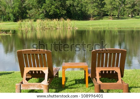 Wood chair on the lake side - stock photo