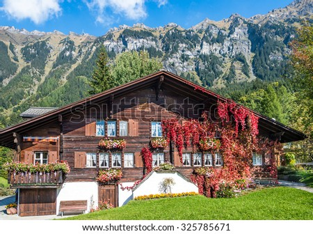 Wood chalet over Swiss Alps. - stock photo