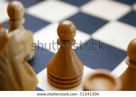 Wood Chess game with pawn detail.
