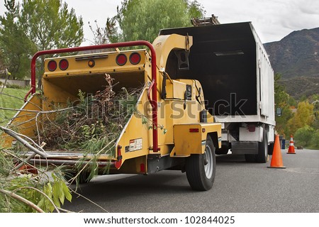 Wood chipper is ready to be use on a cloudy day. - stock photo