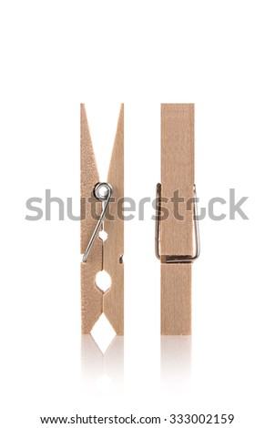 Wood clothespins isolated on white background - stock photo