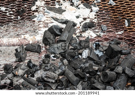 Wood Coal with Ash on Grate. - stock photo