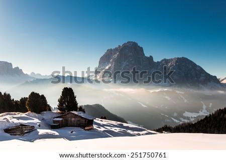 wood cottage in the dolomiti - stock photo
