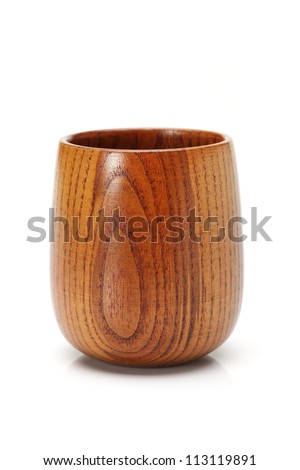 wood craft (cups, bowl, spoons, scoops) on white background - stock photo