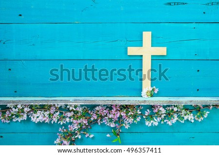Wood Cross Hanging On Antique Rustic Wooden Background Over White And Pink Spring Flowers Easter
