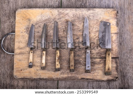 wood cutting board and rusty knife - stock photo