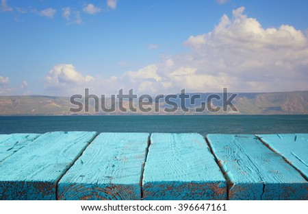 wood deck in front of lake landscape. ready for product display  - stock photo