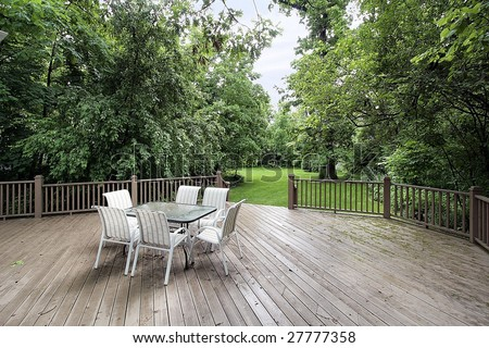 Wood deck with chair and table - stock photo