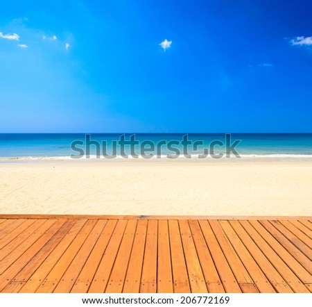 Wood decking and beautiful tropical beach - stock photo