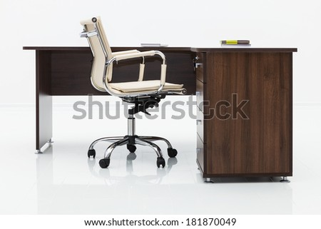 wood desk and chair on a white wall - stock photo