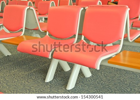 Wood desk and pink soft chair  - stock photo